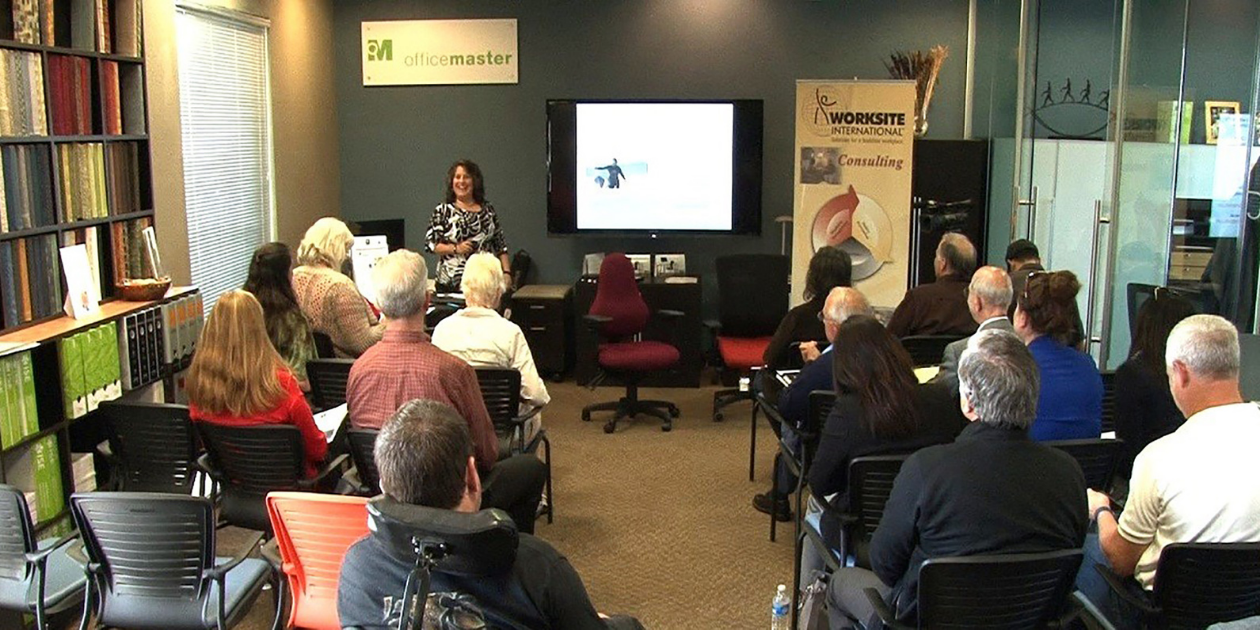 Alison presenting to an audience